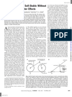 A Bicycle Can Be Self-Stable Without Gyroscopic or Caster Effects
