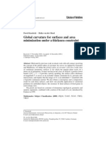 Global Curvature for Surfaces and Area Minimization Under a Thickness Constraint