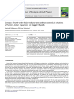 Compact fourth-order finite volume method for numerical solutions of Navier–Stokes equations on staggered grids