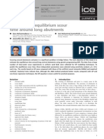 Prediction of Equilibrium Scour Time Around Long Abutments