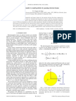 MOMENTUM TRANSFER TO SMALL PARTICLES BY PASSING ELECTRON BEAMS.pdf