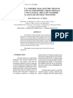 EFFECTS OF A UNIFORM AXIAL ELECTRIC FIELD ON HELICAL FLOW OF CHOLESTERIC LIQUID CRYSTALS BETWEEN TWO COAXIAL CIRCULAR CYLINDERS HAVING ANGULAR AND AXIAL VELOCITIES