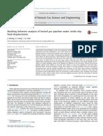Buckling behavior analysis of buried gas pipeline under strike-slip fault displacement