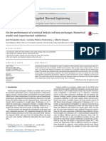On the Performance of a Vertical Helical Coil Heat Exchanger Numerical Model and Experimental Validation