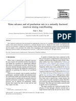 Water advance and oil production rate in a naturally fractured reservoir during waterflooding