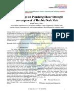 CFRP Strips on Punching Shear Strength Development of Bubble Deck Slab
