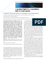 Storage of fiber-guided light in a nanofibertrapped ensemble of cold atoms