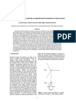 Small-Scale Testing of Laterally Loaded Bucket Foundations in Dense Sand