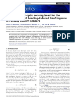 Nonplanar fiber-optic sensing head for the compensation of bending-induced birefringence in Faraday current sensors