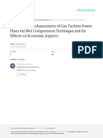 Performance Enhancement of Gas Turbine Power Plant via Wet Compression Technique and Its Effects on Economic Aspects