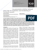 Influence of Low-pozzolanic Activity Calcined Mica Clay on Hydration and Hardening of Portland Cement