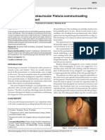 A Rare Case of Postauricular Fistula Communicating With the Parotid Duct