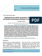 Engineered microbial consortium for the efficient conversion of biomass to biofuels