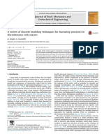 A Review of Discrete Modeling Techniques for Fracturing Processes in Discontinuous Rock Masses