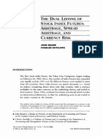 The dual listing of stock index futures_ Arbitrage_ spread arbitrage_ and currency risk.pdf