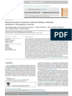 Numerical study for continuous surfactant flooding considering adsorption in heterogeneous reservoir