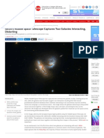 NASA's Hubble Space Telescope Captures Two Galaxies Interacting, Distorting