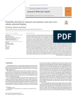 Wettability alteration in carbonate and sandstone rocks due to low salinity surfactant flooding