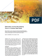 Deformation and the Strip Necking Zone in a Cracked Steel Sheet