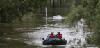 Amid Floodwaters, Residents Make Desperate Treks to Safety Across Houston's Sprawling Freeways
