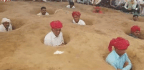 Farmers in India's Rajasthan Sit Neck-Deep in Mud to Protest Forceful Land Acquisition