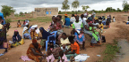 A Crowd Is Waiting For A Cervical Cancer Clinic On Wheels